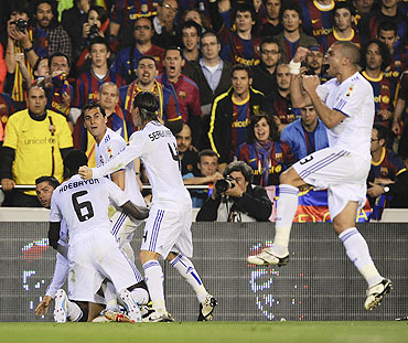 Real Madrid'S Cristiano Ronaldo (left) celebrates with teammates after scoring
