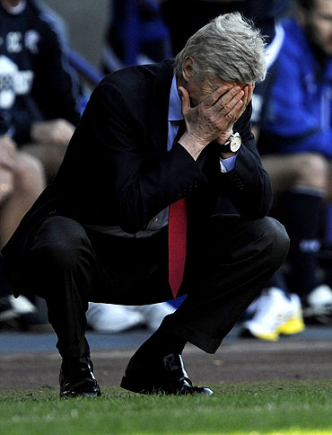 Arsenal's manager Arsene Wenger reacts during the match against Bolton Wanderers