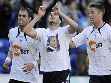 Bolton Wanderers' Tamir Cohen (centre) celebrates with teammates after scoring against Arsenal