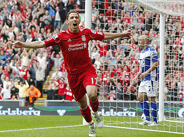 Liverpool's Maxi Rodriguez celebrates after scoring against Birmingham City