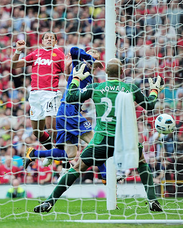 Manchester United's Javier Hernandez heads to score goal against Everton