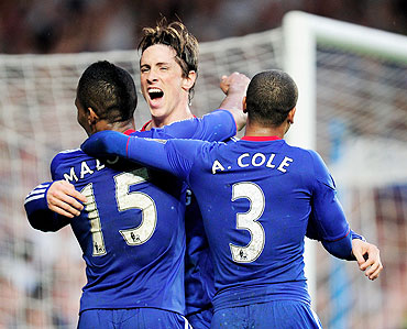 Chelsea's Fernando Torres celebrates with Florent Malouda (left) and Ashley Cole after scoring