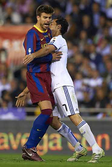 Gerrad Pique in action against Real Madrid player in El Clasico