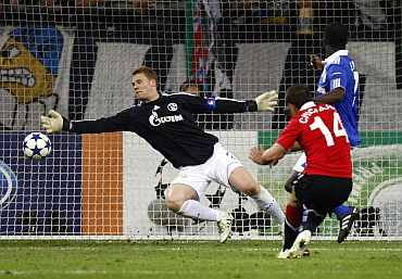 Schalke goalkeeper Neuer makes a save during their Champions League semi-final first leg match against Man United