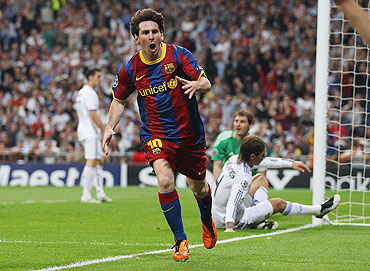 Lionel Messi celebrates after scoring his first goal