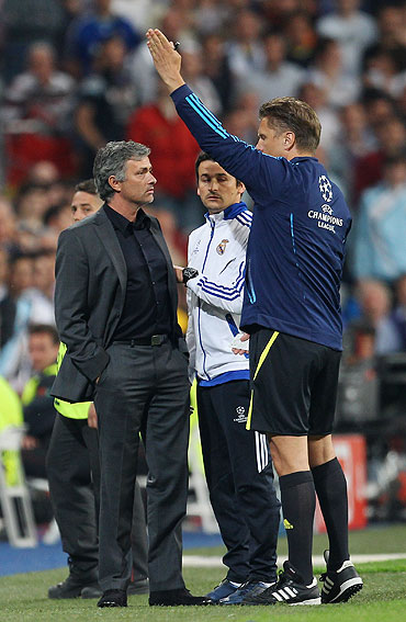 Real Madrid coach Jose Mourinho is sent off to the stands by fourth official, Thorsten Kinhofer