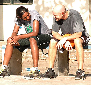 Geetu Anna Jose and Troy Justice take a break during training
