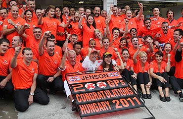 McLaren's Jenson Button celebrates his victory with teammembers in the Hungarian F1 Grand Prix at the Hungaroring circuit on Sunday