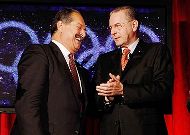The Dow Chemical Company Andrew Liveris and IOC President Jacques Rogge