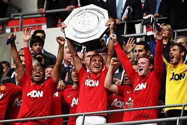 Man United players celebrate after winning the Community Shield