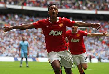Manchester United's Nani celebrates after scoring against Man City