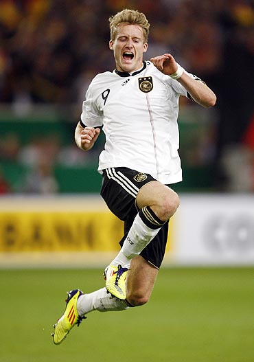 Germany's Andre Schuerle celebrates his goal against Brazil