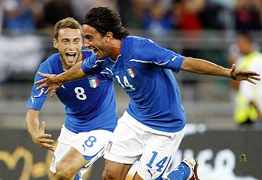 Italy's Alberto Aquilani (right) celebrates with teammate Daniele De Rossi after scoring the second goal against Spain