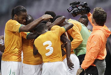 Ivory Coast's players celebrate after scoring against Israel