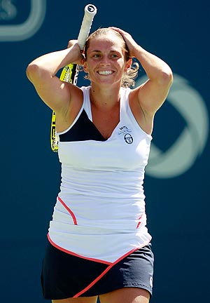 Roberta Vinci reacts after beating Caroline Wozniacki