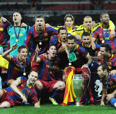 Barcelona players celebrate winning the 2010-11 UEFA Champions League