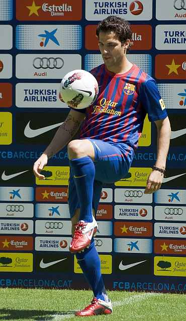 Cesc Fabregas poses for the photographers during his presentation at Camp Nou