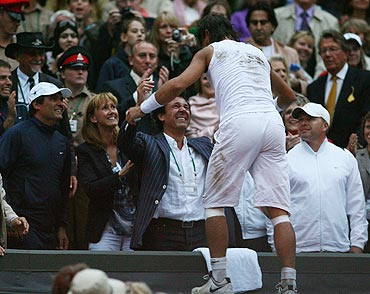 Rafael Nadal celebrates with his parents after winning the 2008 Wimbledon Championships