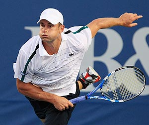 Andy Roddick of the USA serves to Edouard Roger-Vasselin