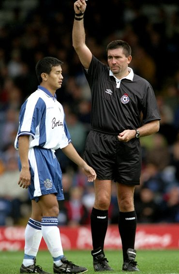 Bhutia is booked during his debut for Bury FC at the Nationwide Division Two match against Cardiff in 1999
