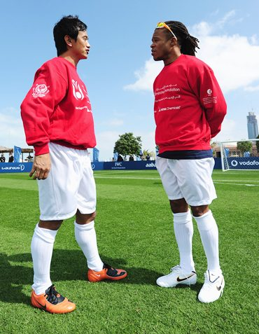 Bhutia with Edgar Davids during the Laureus Football Challenge at the Emirates Palace on February 7, 2011
