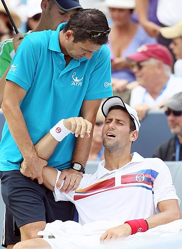 Novak Djokovic is treated by ATP trainer Hugo Gravil during the Cincinnati Open final last week