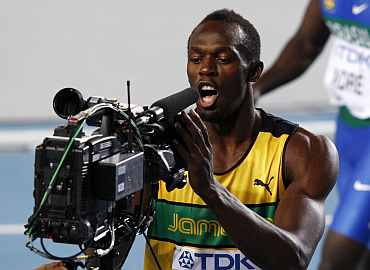 Usain Bolt looks into a TV camera after winning his men's 100 metres heat at the IAAF World Athletics Championships in Daegu