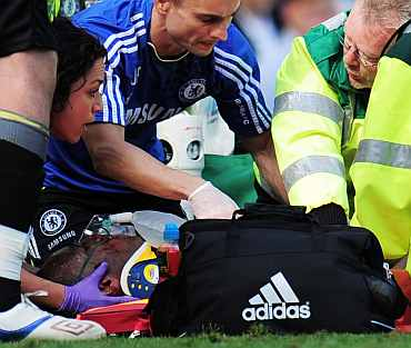 Didier Drogba of Chelsea receives treatment after a collision with goalkeeper John Ruddy of Norwich City