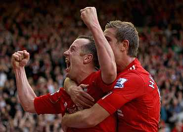 Charlie Adam celebrates scoring his side's third goal with teammate Jordan Henderson
