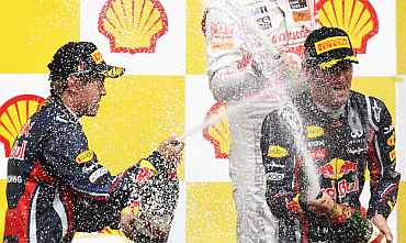 Sebastian Vettel (L) and Mark Webber celebrate after the Belgian Formula One Grand Prix win