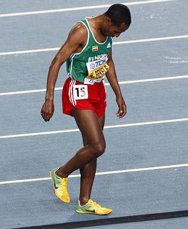 Kenenisa Bekele of Ethiopia leaves the track after pulling out of the men's 10,000 metres final