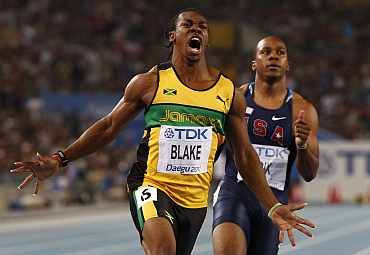 Yohan Blake celebrates winning the men's 100 metres final at the IAAF World Championships in Daegu