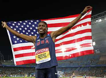 Brittney Reese of the U.S. holds her national flag as she wins the women's long jump final at the IAAF World Championships in Daegu