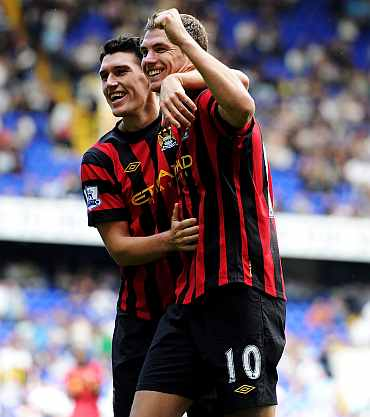 Edin Dzeko celebrates after scoring against Tottenham Hotspur