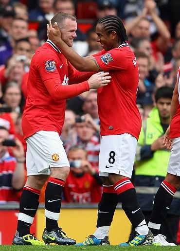 Wayne Rooney celebrates after scoring against Arsenal