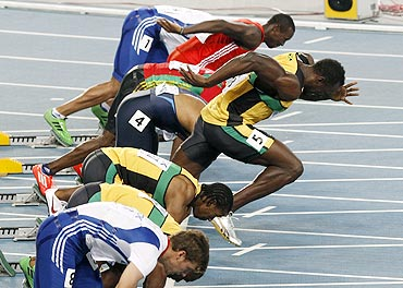 Usain Bolt makes a false start during the men's 100 metres final at the IAAF World Championships in Daegu on Sunday