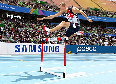 David Greene of Great Britain competes in the men's 400 metres hurdles heats on Monday