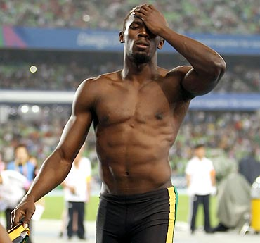 Usain Bolt shows his dejection after being disqualified for a false start