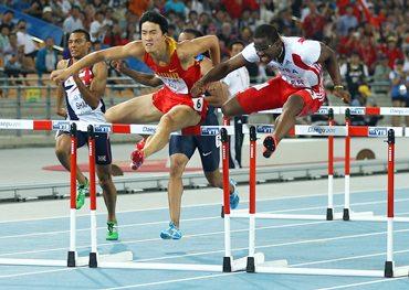 Dayron Robles of Cuba and Xiang Liu (left) of China during the men's 110 metres hurdles final.