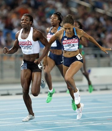 Amantle Montsho of Botswana and Allyson Felix of United States cross the finish line in the women's 400 metres final.