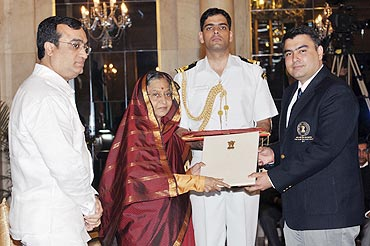 President Pratibha Patil presents the Rajiv Gandhi Khel Ratan Award for the year 2011 to Gagan Narang, as Sports Minister Ajay Maken (left) watches, at Rashtrapati Bhavan on Monday