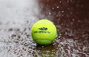 Heavy rain falls on a tennis ball