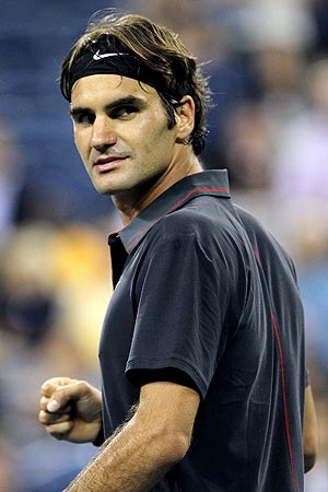 Roger Federer celebrates after defeating Santiago Giraldo in the 1st round of the US Open on Monday