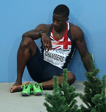 Dwain Chambers of Great Britain shows his dejection after being disqualified for a false start during his men's 100 metres semi-finals on Sunday