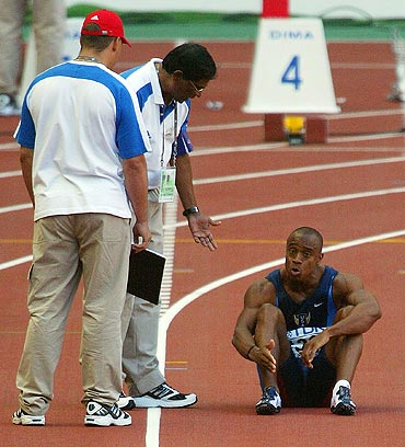Jon Drummond of USA protests his innocence to a false start during the men's 100m quarter-final at the 2003 IAAF World Athletics Championship in Paris