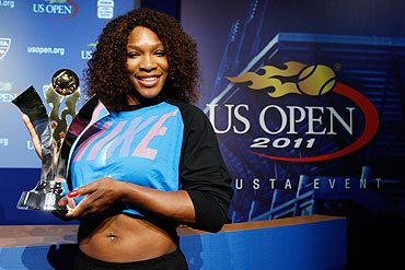 Serena Williams poses with the Olympus US Open Series Trophy
