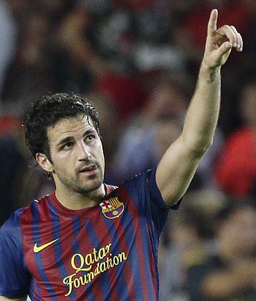 Barcelona's Cesc Fabregas celebrates after scoring against Villarreal on Monday