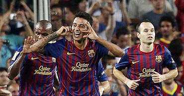 Barcelona's Thiago Alcantara (centre) celebrates after scoring a against Villarreal