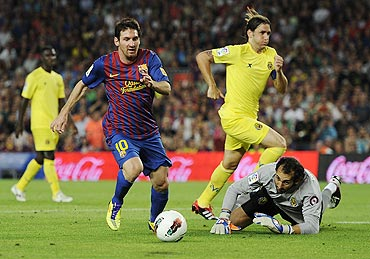 Lionel Messi runs past goalkeeper Diego Lopez to score his team's fourth goal