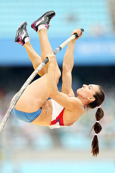 Yelena Isinbaeva competes in the women's pole vault qualification round on Saturday